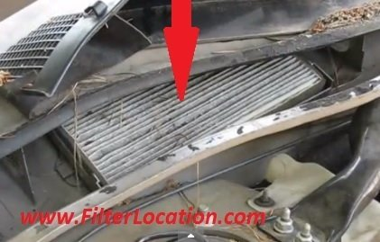 Cabin air filter location and replacement Oldsmobile Intrigue step 2