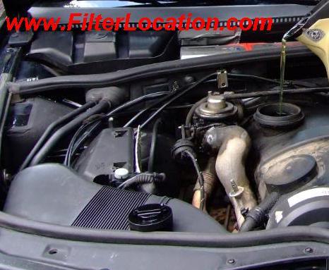 Locate and remove  oil fill cap