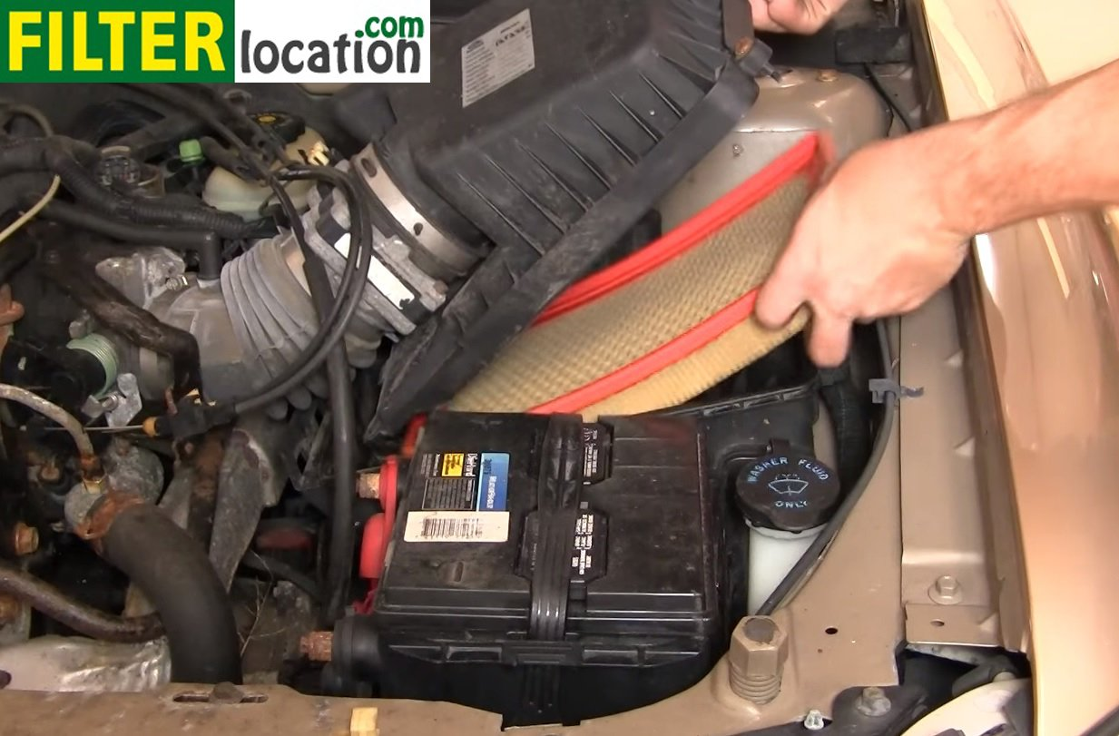 ... Lift the lid of the air box and pull out the old engine air filter, as  you can see below; ...